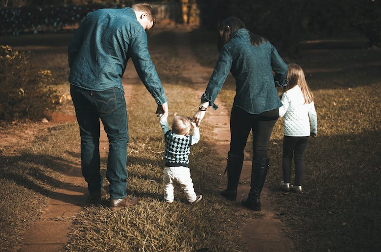 family-walking-on-path