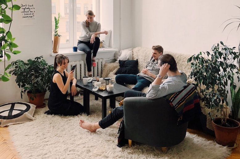 students-relaxing-in-college-apartment